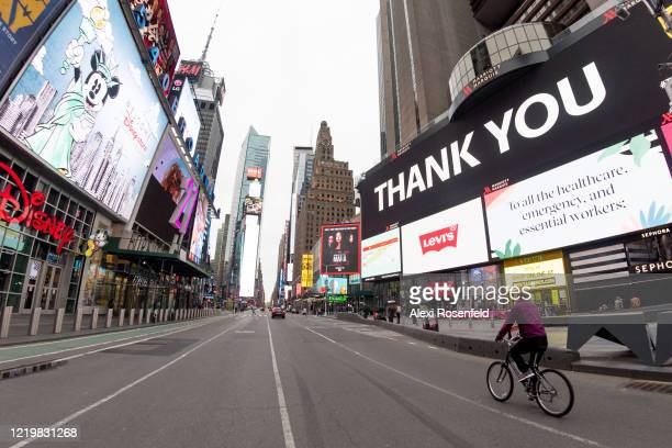 The view looking down an empty 7th Avenue in Times Square amid the coronavirus pandemic on April 19 2020 in New York City United States COVID19 has...