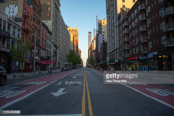 The view looking east down an empty street amid the coronavirus pandemic on April 22 2020 in New York City United States COVID19 has spread to most...