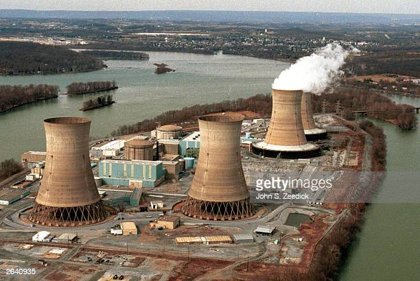 The view looking towards Middletown Pennsylvania reveals Three Mile Island and the damaged reactor number two in the foreground March 15 1999 in...