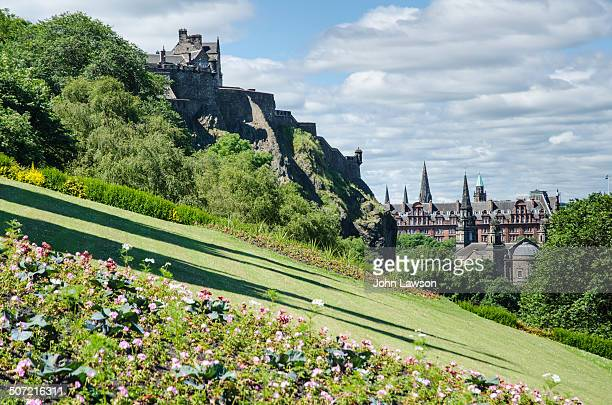 The view looking west from The Mound, Edinburgh, Scotland. On the left of the image is Edinburgh Castle and, on the right, the Parish Church of St...