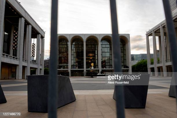 The view of a closed Lincoln Center for the Performing Arts seen through police barricades on May 27 2020 in New York City Government guidelines...