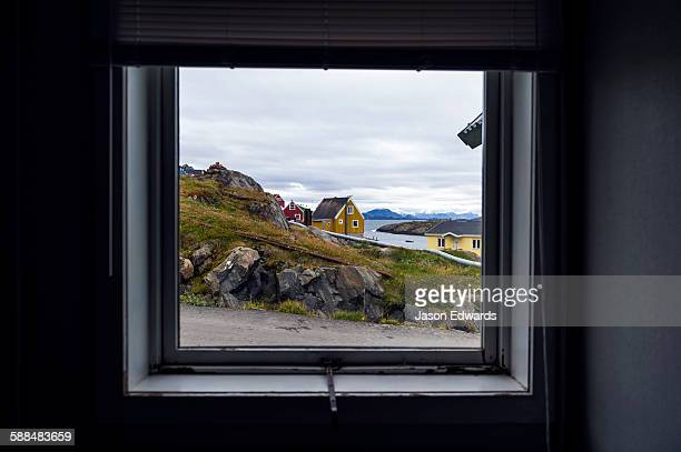 The view of cottages in an arctic village through a weather-sealed window.