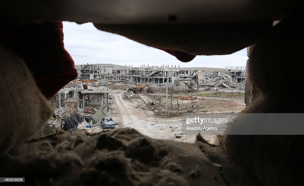 The view of damaged houses during the clashes between the Islamic State of Iraq and Levant (ISIL) and Kurdish armed troops in Kobane (Ayn al-arab) city of Syria, on January 30, 2014.