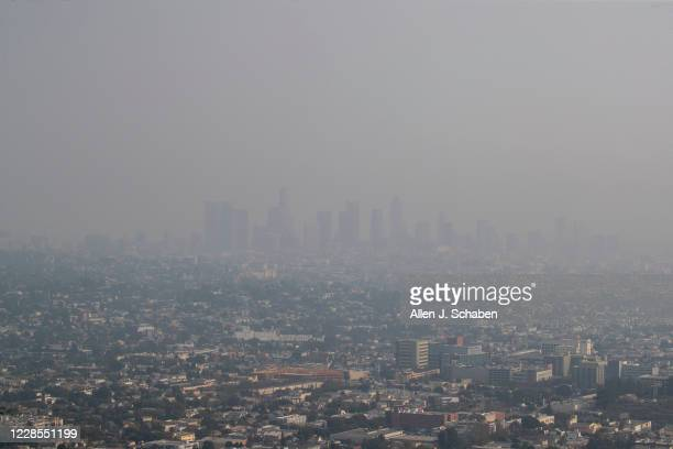The view of downtown Los Angeles skyline is obscured by smoke, ash and smog as seen from the Griffith Observatory Monday, Sept. 14, 2020 in Los...