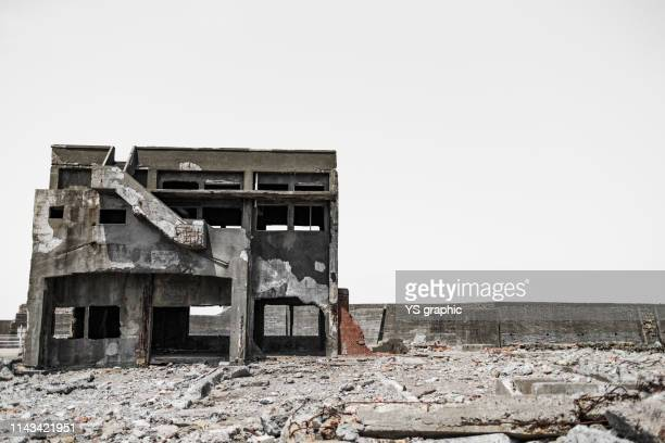the view of gunkanjima - old ruin stock pictures, royalty-free photos & images