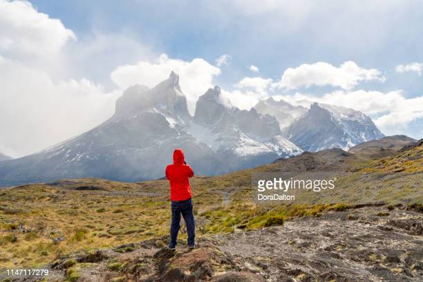 the view of hiking trail in torres del paine national park, chile (parque nacional torres del paine) - foothills stock pictures, royalty-free photos & images