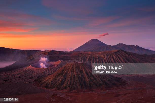 the view of mount bromo and mount batok at sunrise - bromo tengger semeru national park stock photos and pictures