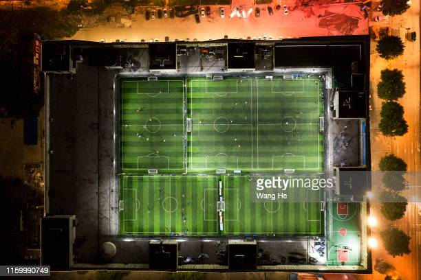 The view of starry sky stadium at market on the roof are seen from an aircraft. Ouyang Nianchi and mens play football here field on July 3.2019 in...