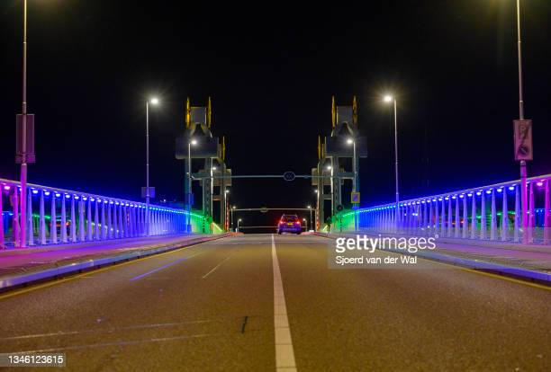 The view of the City Bridge illuminated in rainbow colors for National Coming Out Day, an annual LGBT awareness day on October 11,2021 in Kampen,...