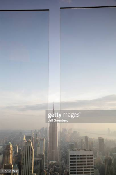 The view of the Empire State Building through the Plexiglas barrier at the Top of the Rock Observation Deck