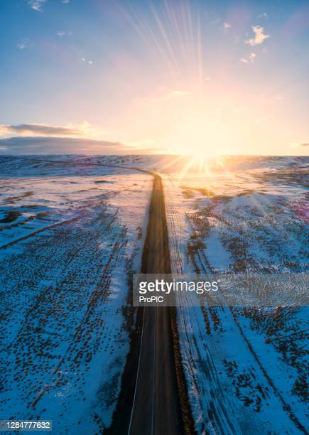 the view of the road is beautiful and covered with snow all around island of iceland. beautiful aerial views using a drone. - wilderness stock pictures, royalty-free photos & images