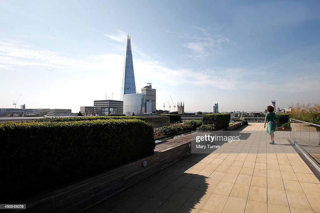 The view of The Shard from the Nomura rooftop gardens, which are opening to the public for the first time as part of Open Garden Squares Weekend 2014, on June 13, 2014 in London, England. Nomura's 6th floor terrace garden with panoramic views across the Thames is one of over 200 usually private gardens which members of the public will be able to explore between June 14th and 15th 2014.