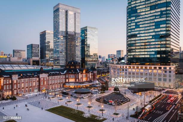 the view of tokyo station and marunouchi at twilight - tokyo station stock photos and pictures