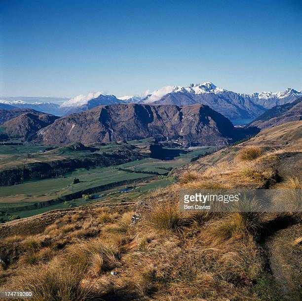 The view towards the snowy peaks of Coronet Peak seen from Skippers Canyon which is one of New Zealand's most scenic areas situated a short distance...