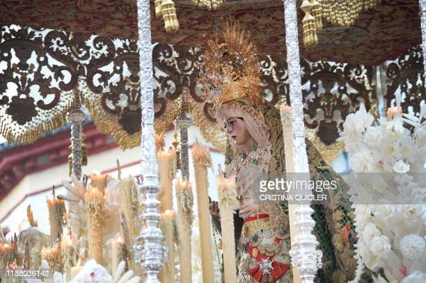 The Vigin of the Esperanza is taken in procession during the 'La Macarena' brotherhood parade during 'The Madruga' procession in Seville as part of...