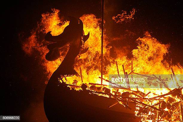 The Viking longboat burns during the annual Up Helly Aa festival in Lerwick Shetland Islands on January 26 2016 Up Helly Aa celebrates the influence...