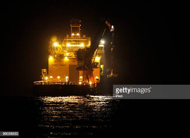 The Viking Poseidon lowers the top hat device at the site of the Deepwater Horizon oil spill May 11 2010 off the coast of Louisiana in the Gulf of...