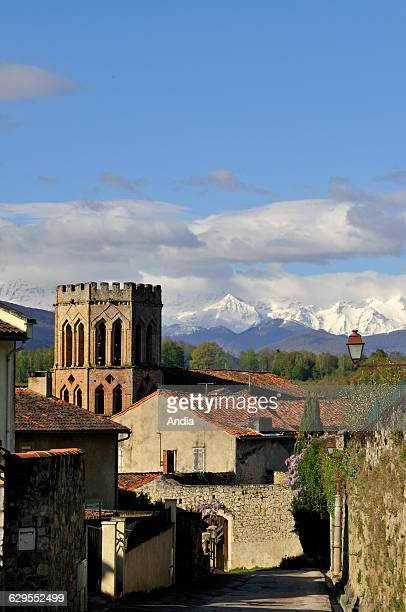 the village and the octogonal steeple of the Church of Saint Lizier typical from Toulouse on the Way of St James in the small province of Couserans...