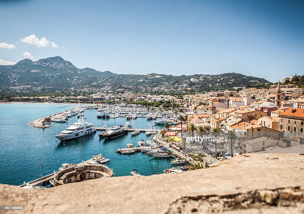 The village and touristic harbor of Calvi, Corsica : Stock Photo