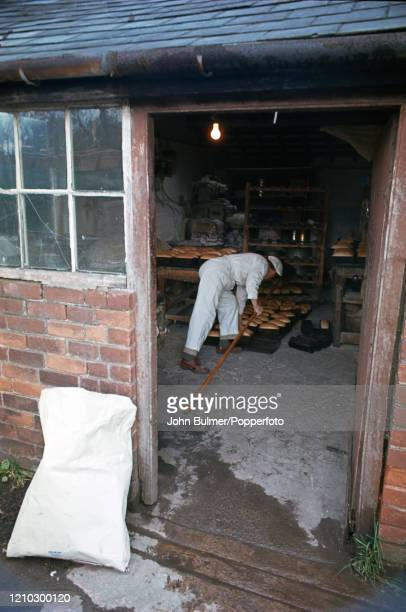 The village baker at work using the old bread ovens in bakery at Pembridge in England circa June 1966 During the summer of 1966 British...
