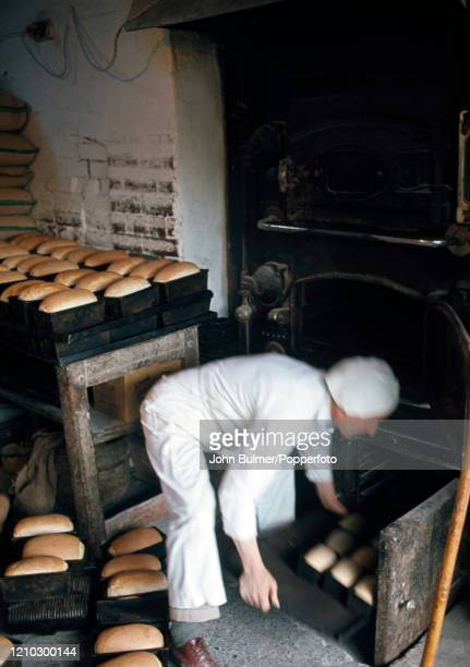 The village baker working with the old bread ovens in the bakery at Pembridge in England circa June 1966 During the summer of 1966 British...