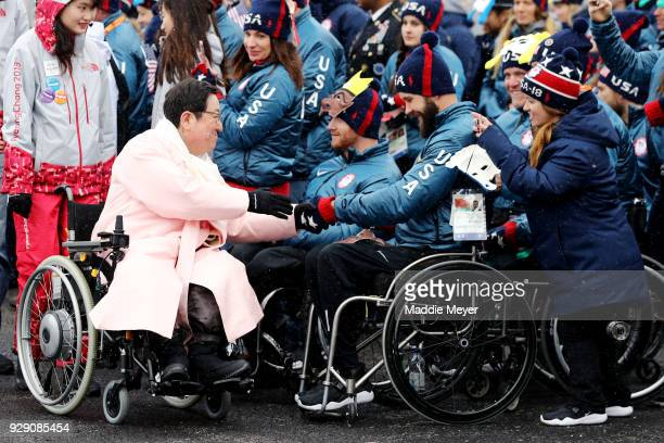 The village mayor EunSoo Park shakes hands with members of the United States paralympic team during the Welcoming Ceremony at the PyeongChang Olympic...