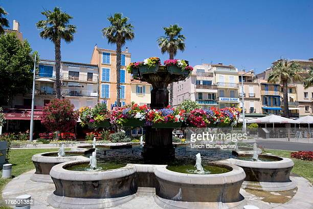 The village of Bandol with fountain flowers and palm trees on June 22 2013 in Bandol Cote d'Azur France