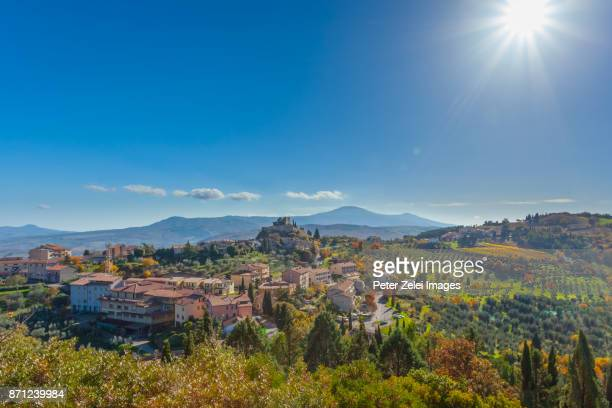 the village of castiglione d'orcia surrounded with olive tree plantations in tuscany, italy - siena italia foto e immagini stock