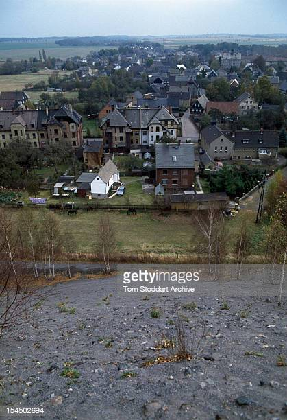 The village of Crossen East Germany seen from the top of a uranium waste heap produced by a local mine 1st March 1991