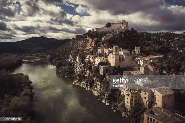 the village of miravet at the ebro river in tarragona catalonia spain - tarragona stock photos and pictures