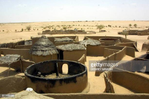 The village of Tundubai in Sudan's Darfur region burnt down by the marauding Janjaweed Arab militias is seen 31 July 2004 The Sudanese government...