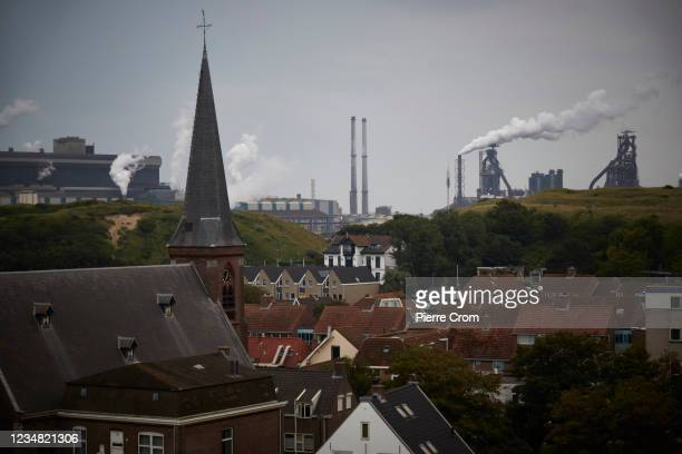 The village of Wijk aan Zee is seen with on the background the Tata Steel plant on August 21, 2021 in Wijk aan Zee, Netherlands. The Tata steel plant...