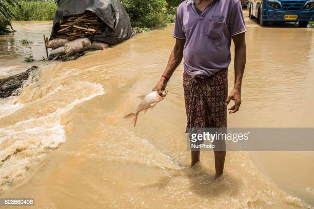The villagers are doing fishing in the flood water Udainarayanpur India 2872017On Thursday 27th July 2017 Damodar Valley Corporation release more...