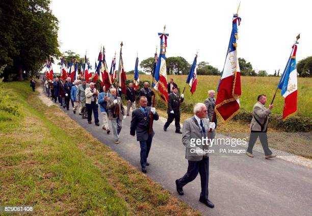 The villagers of Magneville in Normandy march to a memorial in their village to soldiers of the American 101st Airborne Division who were shot down...