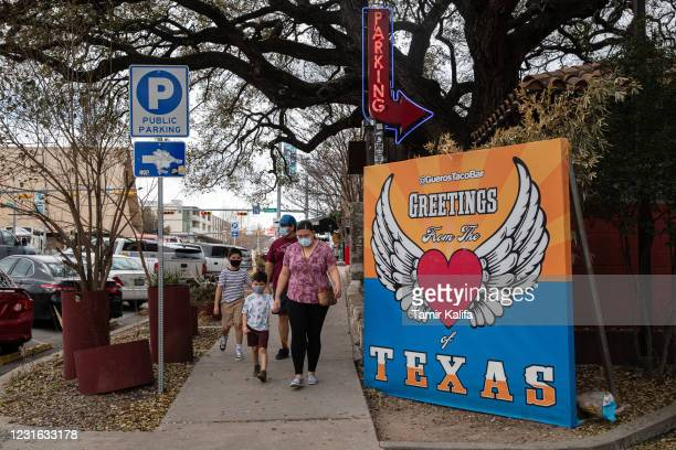 The Villalobos family walks along South Congress Avenue on March 10, 2021 in Austin, Texas. The City of Austin said it will continue to maintain its...