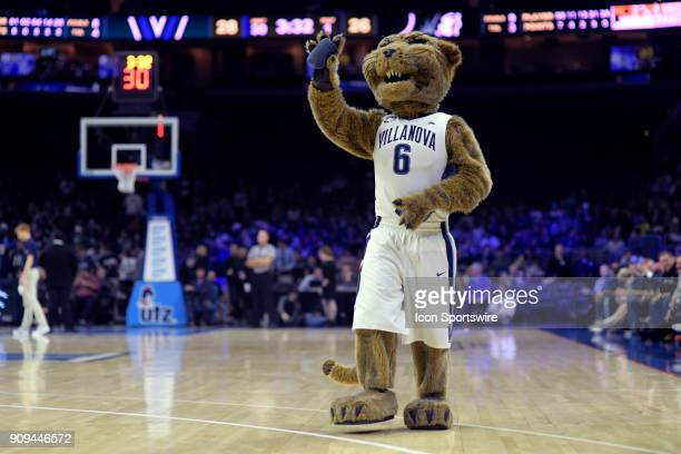 The Villanova mascot throws tee shirts into the audience during the college basketball game between the Providence Friars and the Villanova Wildcats...