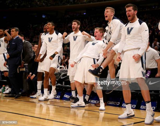 The Villanova Wildcats bench reacts to a teammate's three point shot in the second half against the Marquette Golden Eagles during quarterfinals of...