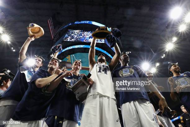 The Villanova Wildcats celebrate after defeating the Michigan Wolverines during the 2018 NCAA Men's Final Four National Championship game at the...