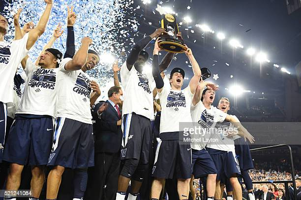 The Villanova Wildcats celebrate after winning the NCAA College Basketball Tournament Championship game against the North Carolina Tar Heels at NRG...