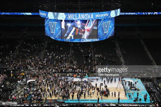 The Villanova Wildcats celebrate and cut down the net after defeating the Michigan Wolverines during the 2018 NCAA Men's Final Four National...