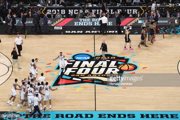 The Villanova Wildcats celebrate as the Michigan Wolverines walk off the court during the 2018 NCAA Men's Final Four National Championship game at...