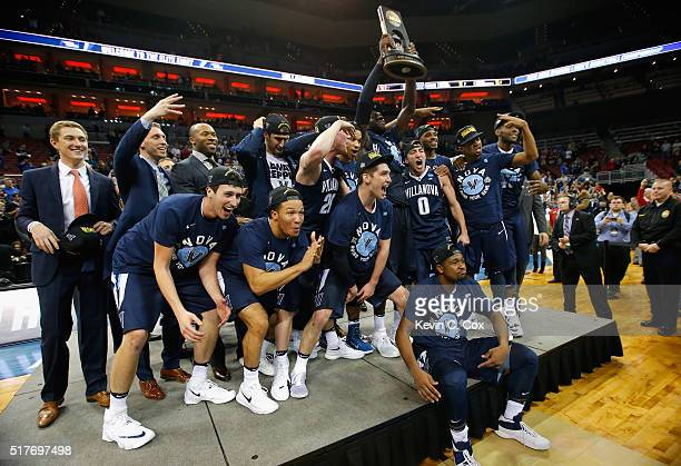 The Villanova Wildcats celebrate defeating the Kansas Jayhawks 6459 during the 2016 NCAA Men's Basketball Tournament South Regional at KFC YUM Center...