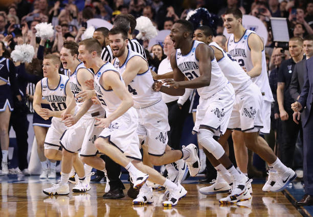 The Villanova Wildcats celebrate defeating the Texas Tech Red Raiders 7159 in the 2018 NCAA Men's Basketball Tournament East Regional to advance to...