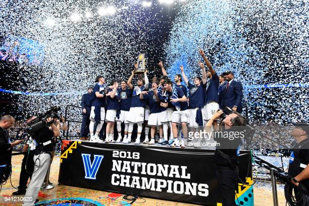 The Villanova Wildcats celebrate on stage after the 2018 NCAA Photos via Getty Images Men's Final Four National Championship game against the...