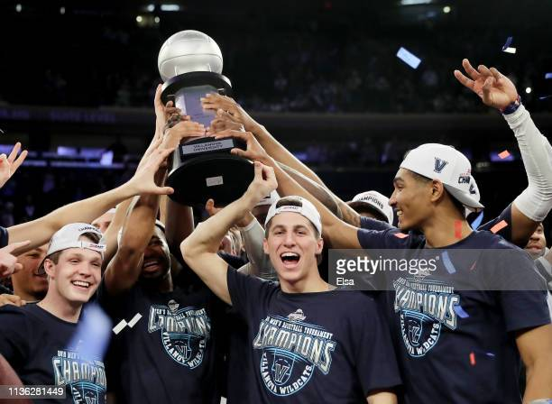 The Villanova Wildcats celebrate the 74-72 win over the Seton Hall Pirates to take the Big East Championship title at Madison Square Garden on March...