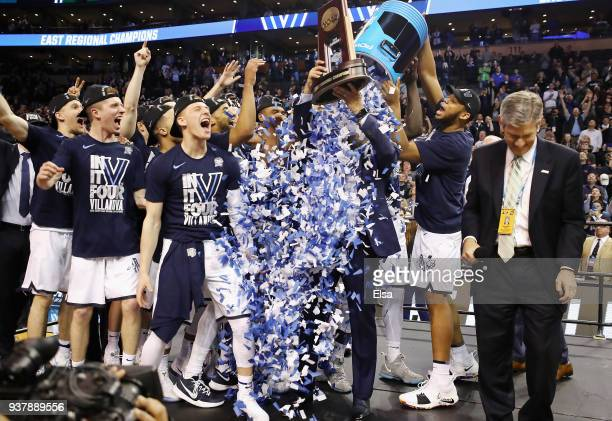 The Villanova Wildcats celebrate with head coach Jay Wright and the East Regional Champion trophy after defeating the Texas Tech Red Raiders 7159 in...