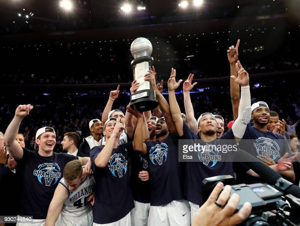 The Villanova Wildcats celebrate with the championship trophy after their overtime win over the Providence Friars during the championship game of the...
