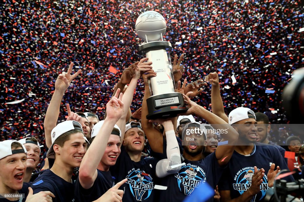 The Villanova Wildcats celebrate with the championship trophy after their overtime win over the Providence Friars during the championship game of the Big East Basketball Tournament at Madison Square Garden on March 10, 2018 in New York City.