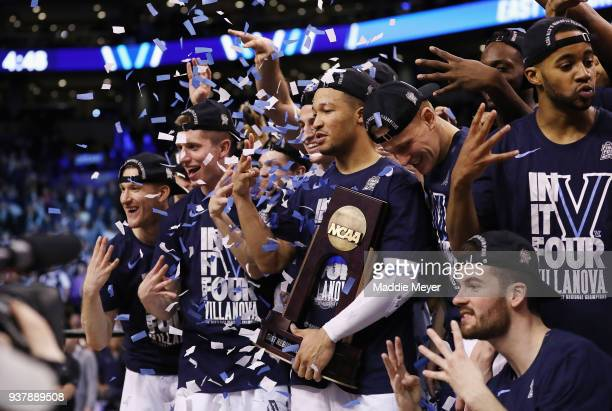 The Villanova Wildcats celebrate with the East Regional Champion trophy after defeating the Texas Tech Red Raiders 7159 in the 2018 NCAA Men's...