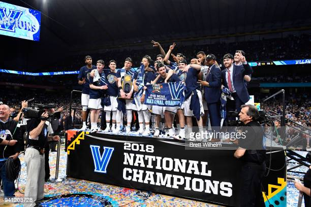 The Villanova Wildcats celebrate with the trophy after the 2018 NCAA Photos via Getty Images Men's Final Four National Championship game against the...